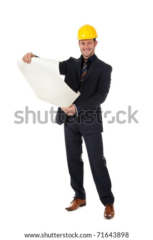 Young caucasian man architect with helmet and holding plans. Studio shot. White background. - stock photo