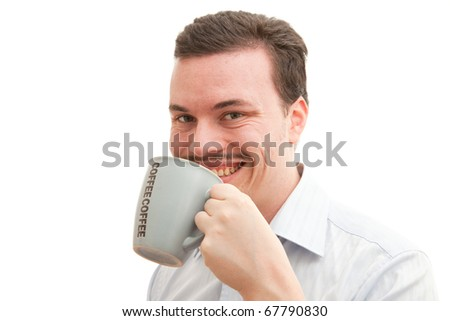Young caucasian man drinking coffee - stock photo