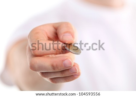 Young caucasian man holding a two euro coin. Image with shallow depth of field. The coin is in focus. - stock photo