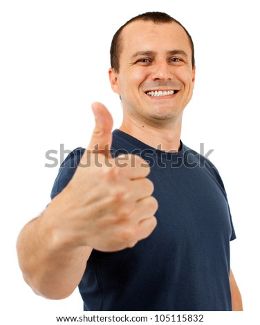 Young caucasian man making thumbs up sign