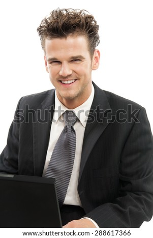 Young Caucasian man smiling and happy working on laptop indoors over white background. - stock photo