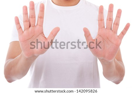 Young caucasian man sowing his hands palm, isolated on white background - stock photo