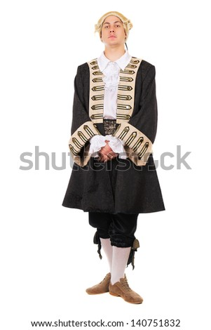 Young caucasian man wearing medieval costume and wig. Isolated on white