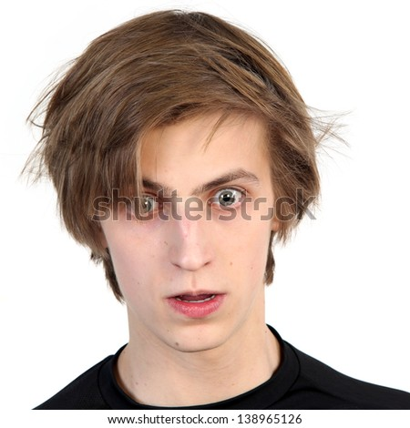 Young caucasian man with amazed scared face expression,  on white background