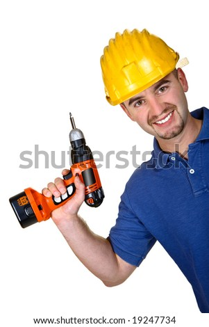 Young caucasian manual worker with  drill background - stock photo