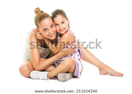Young Caucasian mother and daughter sitting on the floor hugging and smiling looking at camera isolated on white background. - stock photo