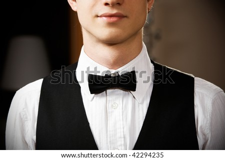 young caucasian waiter is wearing the uniform - stock photo