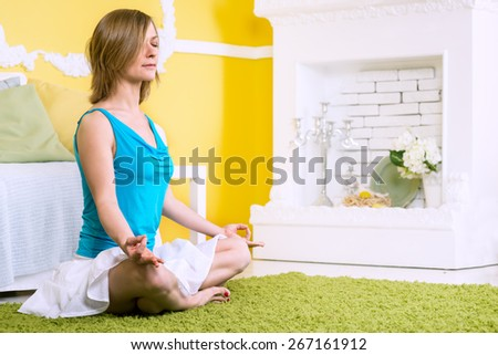 young caucasian woman doing yoga at home - stock photo