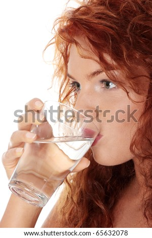 Young caucasian woman drinking water from glass, isolated on white - stock photo