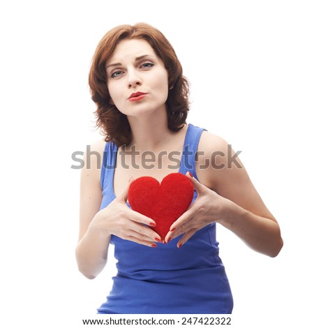 Young caucasian woman in her twenties holding the red heart, isolated over the white background - stock photo