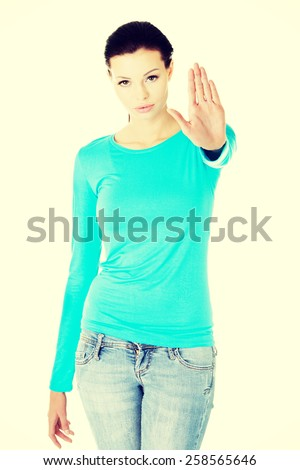 Young caucasian woman making stop sign with her hand. - stock photo