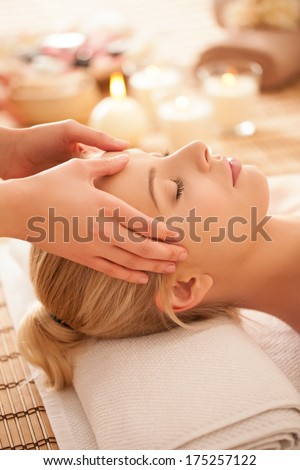 Young Caucasian woman on a head massage. - stock photo