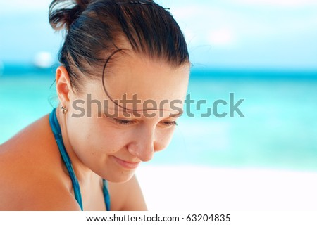 Young caucasian woman on tropical beach.