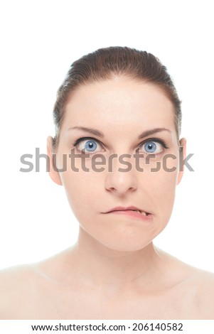 Young caucasian woman portrait with a bemused facial expression, isolated over the white background, natural make up and postprocessing - stock photo