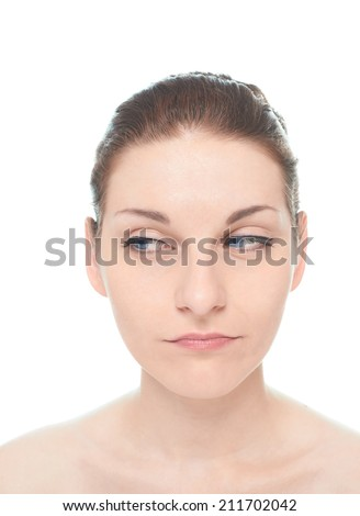 Young caucasian woman portrait with an arrogant but interested facial expression, isolated over the white background, natural make up and postprocessing