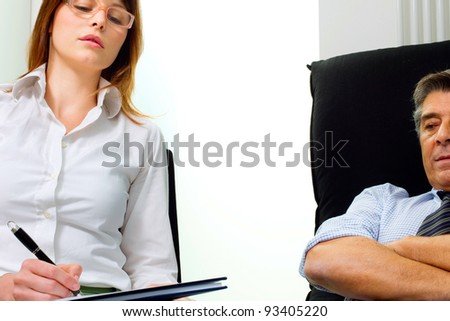 young caucasian woman psychiatrist with patient - stock photo