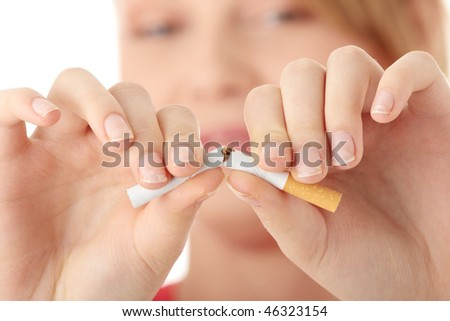Young caucasian woman quiting smoking isolated on white background - stock photo