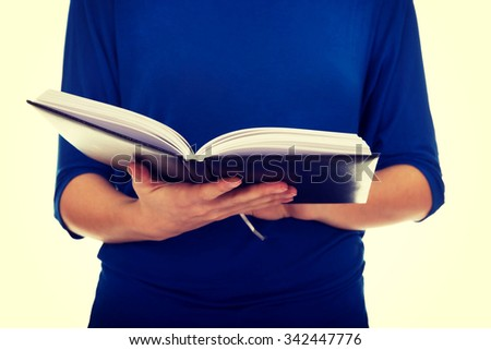 Young caucasian woman reading a book. - stock photo