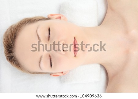 Young Caucasian woman seen from above on a white background - stock photo