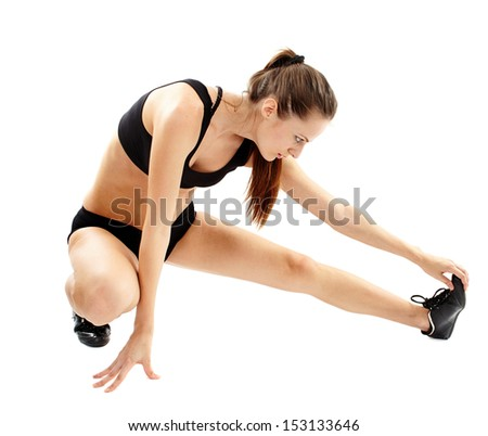 Young caucasian woman stretching, doing aerobics. Isolated on white.