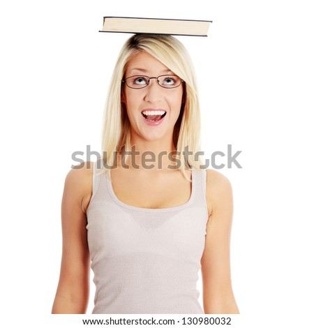 Young caucasian woman (student) with book on her head - stock photo