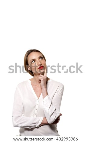 Young Caucasian woman thinking - stock photo