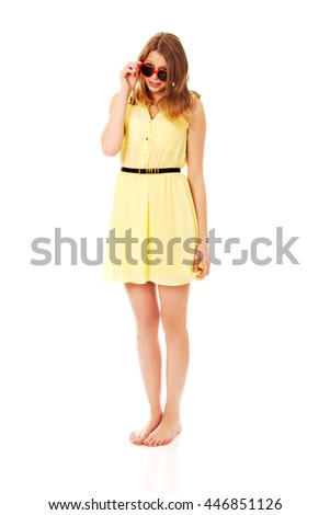 Young caucasian woman wearing skirt and sunglasses - stock photo