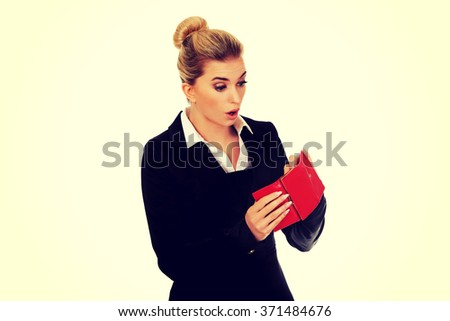 Young caucasian woman with empty wallet - broke - stock photo