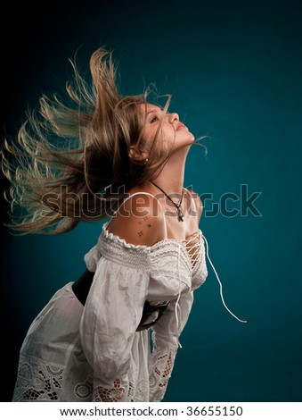 Young caucasian woman with hair flying in the air. - stock photo