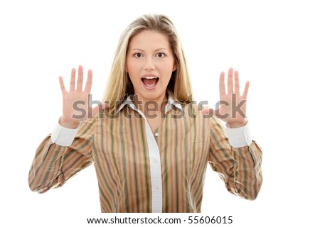 Young caucasian woman with hands up, isolated on white background - stock photo