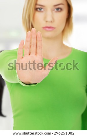 Young caucasian woman with stop gesture. - stock photo