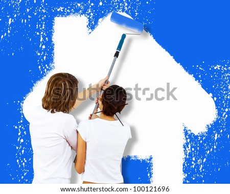 Young caucausian couple with paint brushes together - stock photo