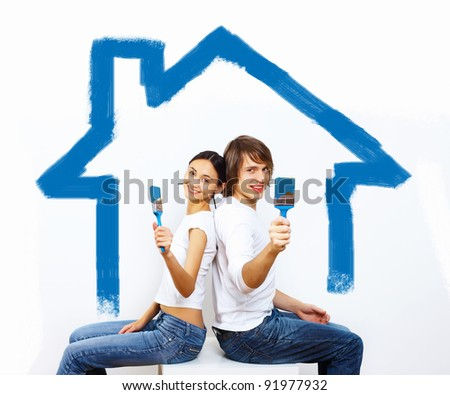 Young caucausian couple with paint brushes together