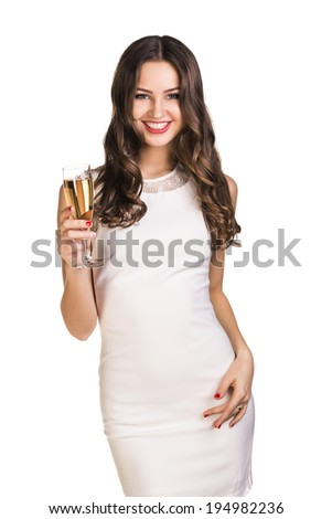 Young celebrating woman in white dress . Beautiful model portrait isolated over white background hold wine glass.