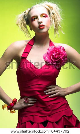 Young charming blond woman with bright visage and in sexy dress