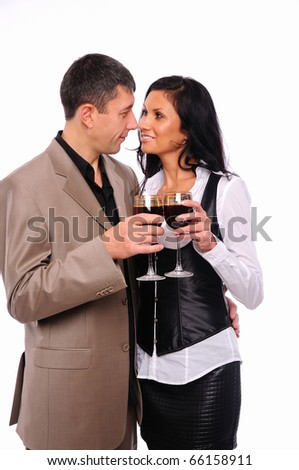 Young charming couple - a man and a woman, drinking red wine in honor of Valentine's Day - stock photo