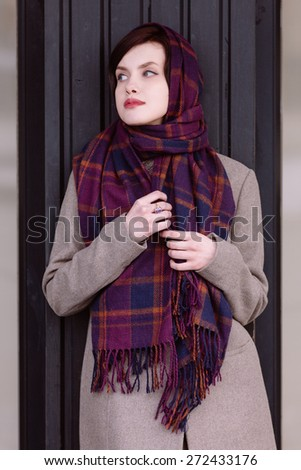 Young charming girl waiting for someone - stock photo