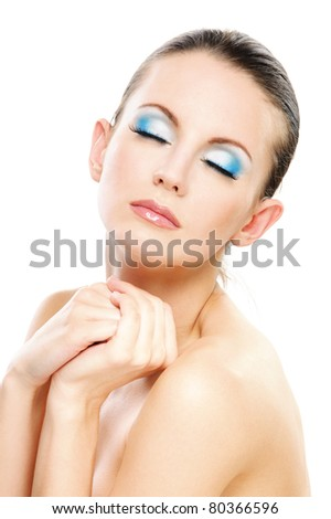 Young charming woman has closed eyes and enjoys silence, on white background.