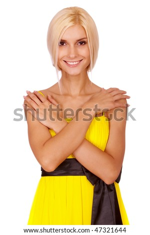 Young charming woman in yellow dress smiles, it is isolated on white background. - stock photo