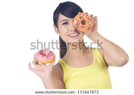 Young cheerful asian girl smiling  with donut in her  hand  white background - stock photo