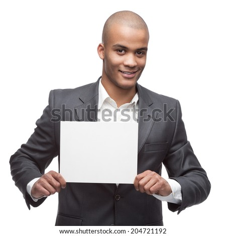 young cheerful black businessman holding sign isolated on white