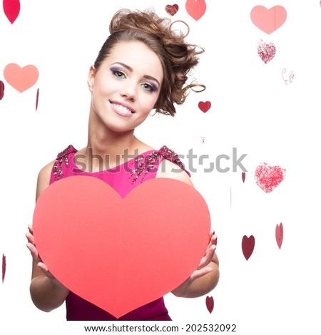 young cheerful caucasian brunette woman holding big red paper heart - stock photo