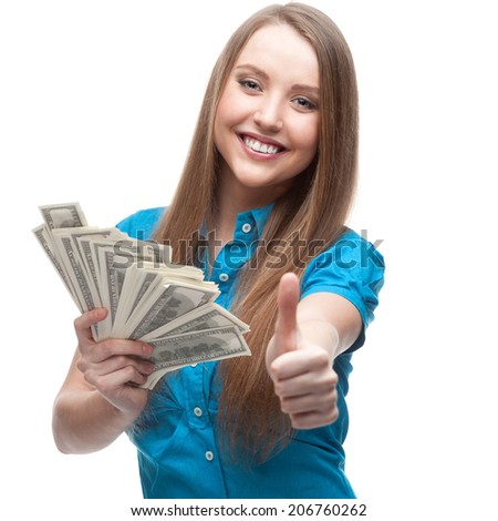 young cheerful caucasian businesswoman in blue blouse holding money and showing thumbs up isolated on white