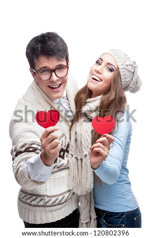 young cheerful caucasian funny naked man holding big red paper heart isolated on white background with falling red hearts - stock photo