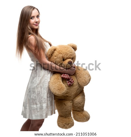 young cheerful caucasian girl in short white dress holding big soft toy bear isolated on white - stock photo