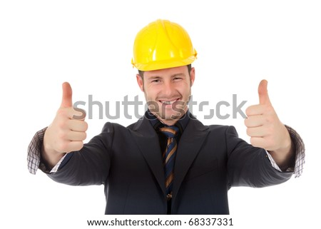 Young cheerful caucasian man architect with helmet and thumbs up. Positive attitude. Studio shot. White background. - stock photo