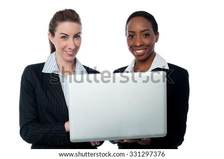 Young cheerful executives working on laptop