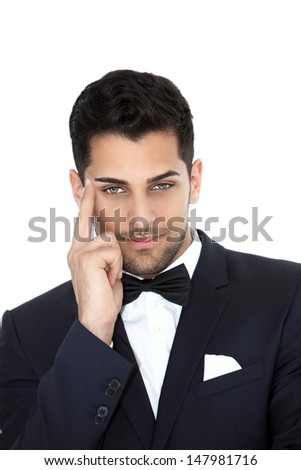 Young cheerful groom looking in a front view shot - stock photo