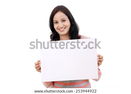 Young Cheerful Indian woman holding billboard on white background - stock photo
