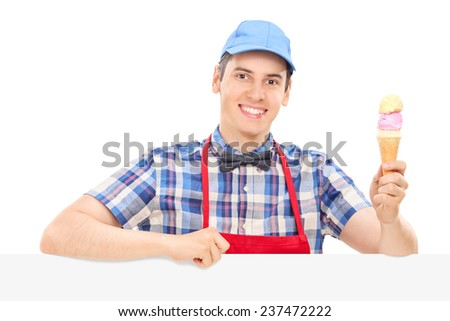 Young cheerful man holding an ice cream isolated on white background - stock photo